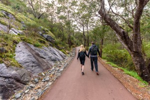 A couple walks along a trail at Serpentine National Park